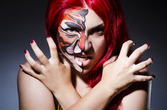 Donna con la pittura del fronte Immagini Stock