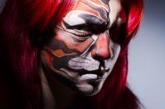 Donna con la pittura del fronte Immagini Stock Libere da Diritti