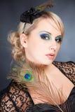 Donna con la piuma Fotografia Stock