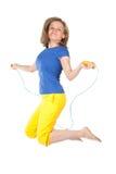 Donna con la saltare-corda Immagini Stock