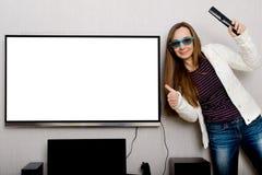 Donna con la TV Fotografia Stock Libera da Diritti