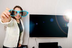 Donna con la TV Fotografia Stock