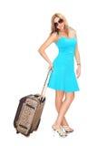 Donna con la valigia di corsa Fotografia Stock