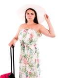 Donna con la valigia rossa di A su un fondo bianco Fotografia Stock