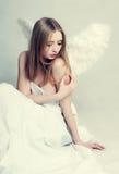 Donna con le ali di angelo Immagini Stock