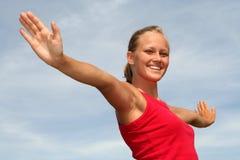 Donna con le braccia outstretched Immagine Stock