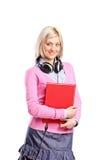 Donna con le cuffie che tengono un taccuino Fotografie Stock Libere da Diritti