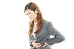 Donna con le edizioni dello stomaco Fotografia Stock Libera da Diritti