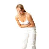 Donna con le emissioni dello stomaco Fotografie Stock