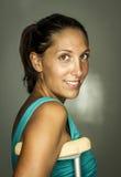 Donna con le grucce Fotografia Stock