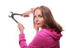 Donna con le pinze, isolate Fotografie Stock Libere da Diritti