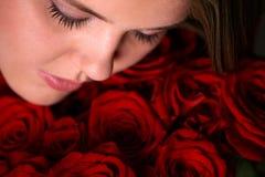 Donna con le rose Immagine Stock