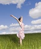 Donna con le sue braccia alzate Fotografia Stock