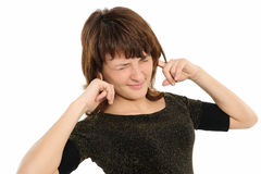 Donna con le sue mani che coprono le sue orecchie Fotografia Stock Libera da Diritti