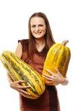 Donna con le zucche Fotografie Stock