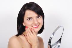 Donna con lo specchio Fotografie Stock
