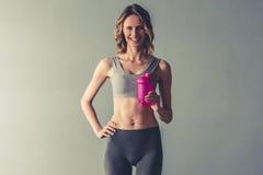 Donna con nutrizione di sport Immagine Stock Libera da Diritti