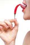 Donna con peperoncino isolato Fotografia Stock