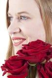 Donna con roses.GN rosso Fotografie Stock Libere da Diritti