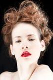 Donna con rossetto rosso Fotografia Stock