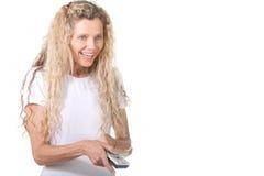 Donna con telecomando Fotografia Stock