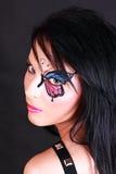 Donna con trucco della farfalla Immagine Stock