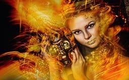 Donna con trucco dorato Fotografie Stock Libere da Diritti