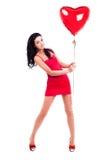 Donna con un aerostato Fotografia Stock