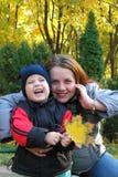 Donna con un bambino Fotografia Stock Libera da Diritti