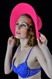 Donna con un cappello del sole Fotografie Stock