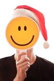 Donna con un cappello rosso di Santa Claus Immagine Stock