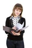 Donna con un copy-book. Isolato su bianco. Fotografia Stock