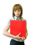 Donna con un dispositivo di piegatura rosso Fotografia Stock
