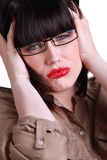 Donna con un'emicrania Fotografia Stock
