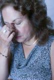 Donna con un'emicrania Fotografia Stock Libera da Diritti