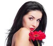 Donna con un fiore Fotografia Stock Libera da Diritti