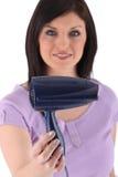 Donna con un hairdryer Fotografia Stock Libera da Diritti