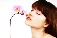 Donna con un'orchidea Fotografia Stock