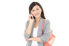 Donna con un phone  astuto Fotografia Stock Libera da Diritti