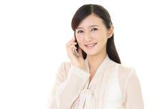 Donna con un phone  astuto Fotografia Stock