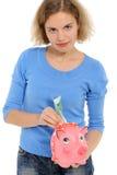 Donna con un piggybank Fotografie Stock