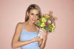 Donna con un POT dei fiori. Immagini Stock Libere da Diritti
