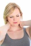 Donna con un torcicollo nel suo collo Fotografie Stock