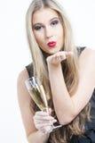 Donna con un vetro di Champagne Immagini Stock
