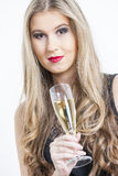 Donna con un vetro di Champagne Fotografia Stock