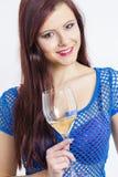 Donna con un vetro di vino bianco Fotografia Stock