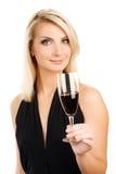 Donna con un vetro di vino rosso Fotografia Stock