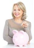 Donna con una banca del maiale Fotografie Stock