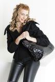 Donna con una borsa Immagini Stock Libere da Diritti