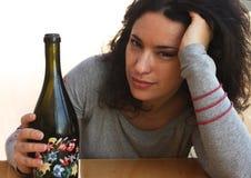 Donna con una bottiglia Fotografia Stock Libera da Diritti